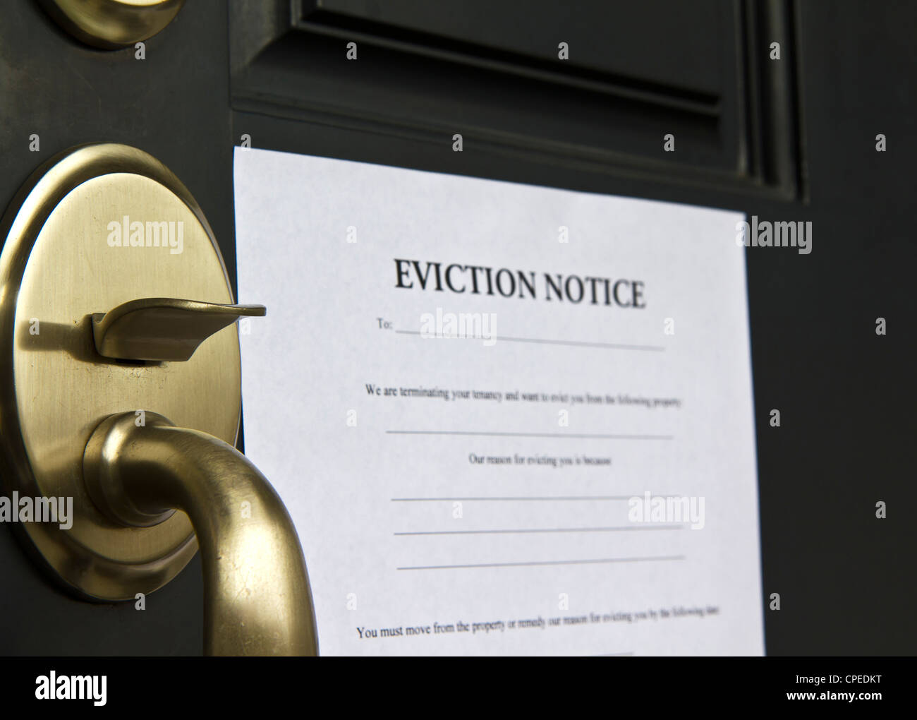 Eviction Notice Letter Posted On Front Door Of House Stock Photo