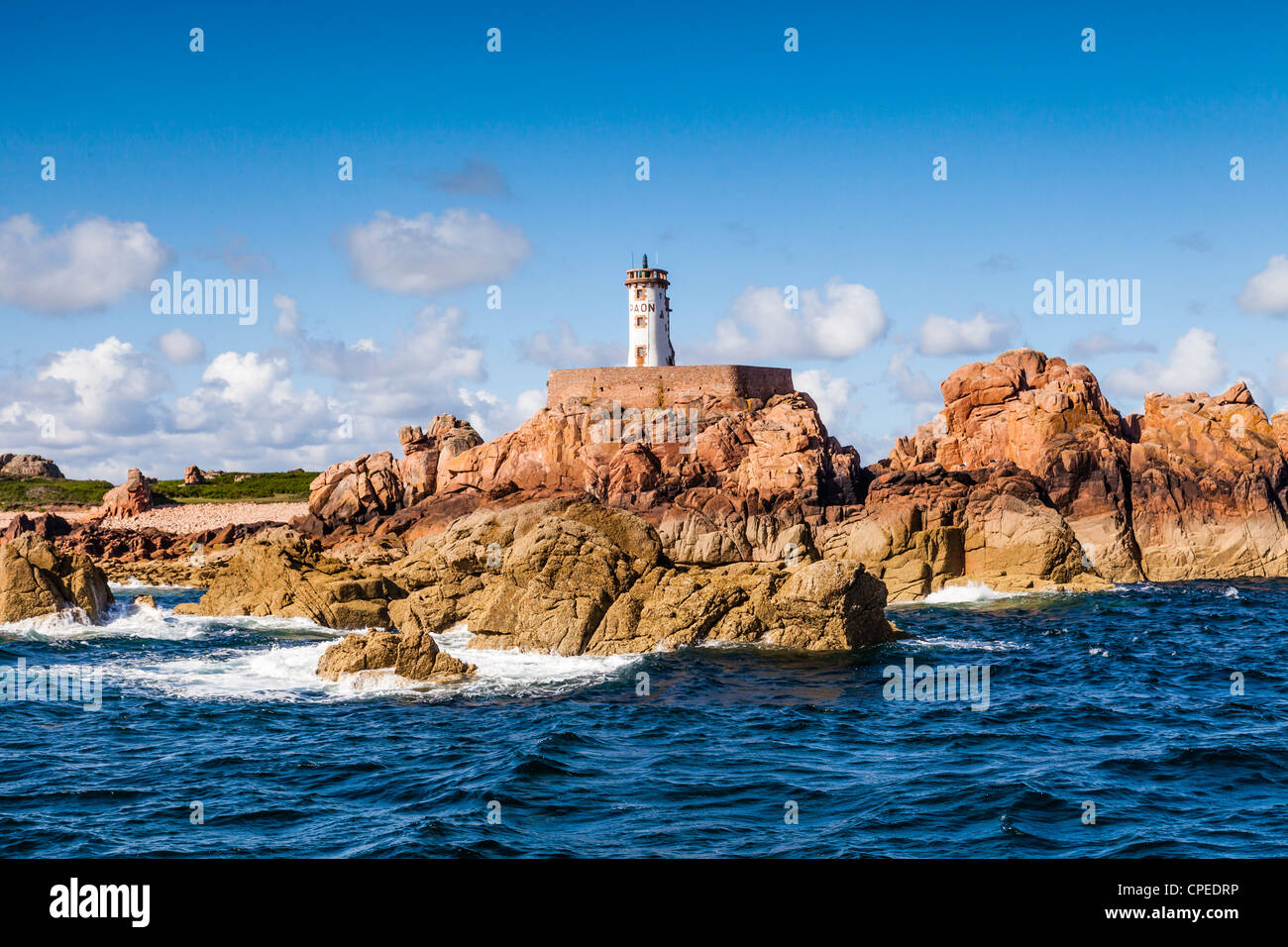 Lighthouse on the Île de Bréhat, on the Pink Granite Coast, Brittany, France, seen from the sea. - Stock Image