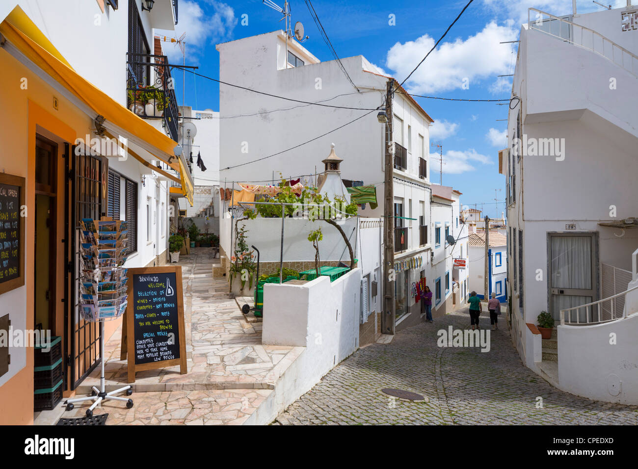 street in the small fishing village of burgau on the coast. Black Bedroom Furniture Sets. Home Design Ideas
