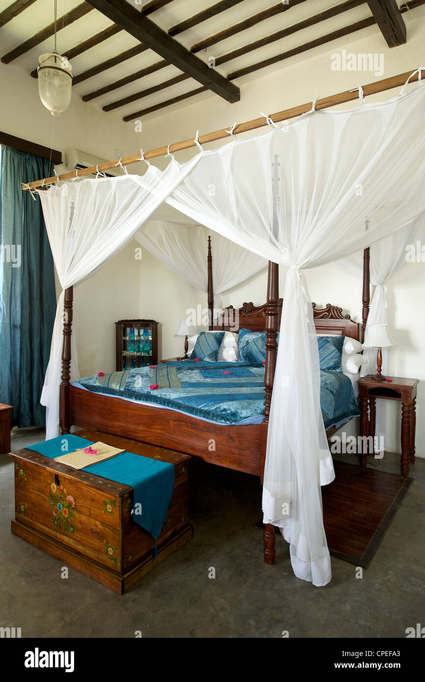 Bedroom of the Ibo lodge on Ibo island in the Quirimbas archipelago off the coast of northern Mozambique. - Stock Image