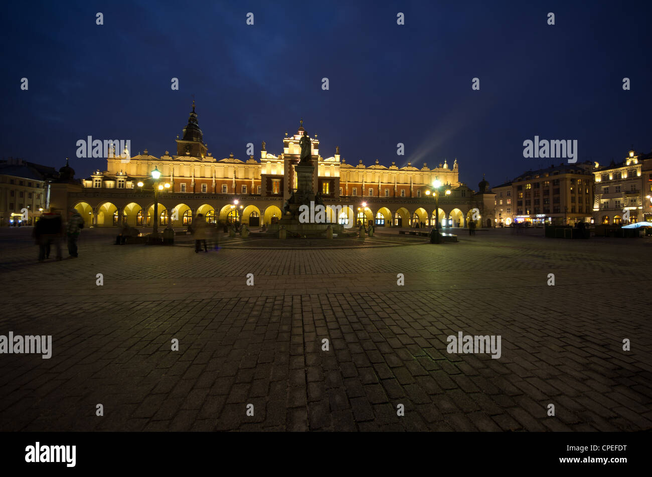 The magnificent Renaissance-era Cloth Hall in the Market square of Rynek Glowny in Krakow Poland, at dusk. The center - Stock Image