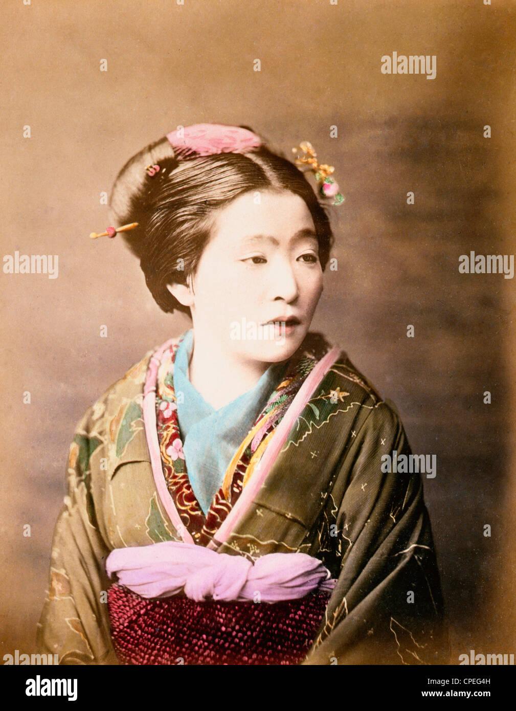 Ukiyo-e beauty, half-length studio portrait of a woman, facing slightly right, Japan woodblock print, circa 1877 - Stock Image