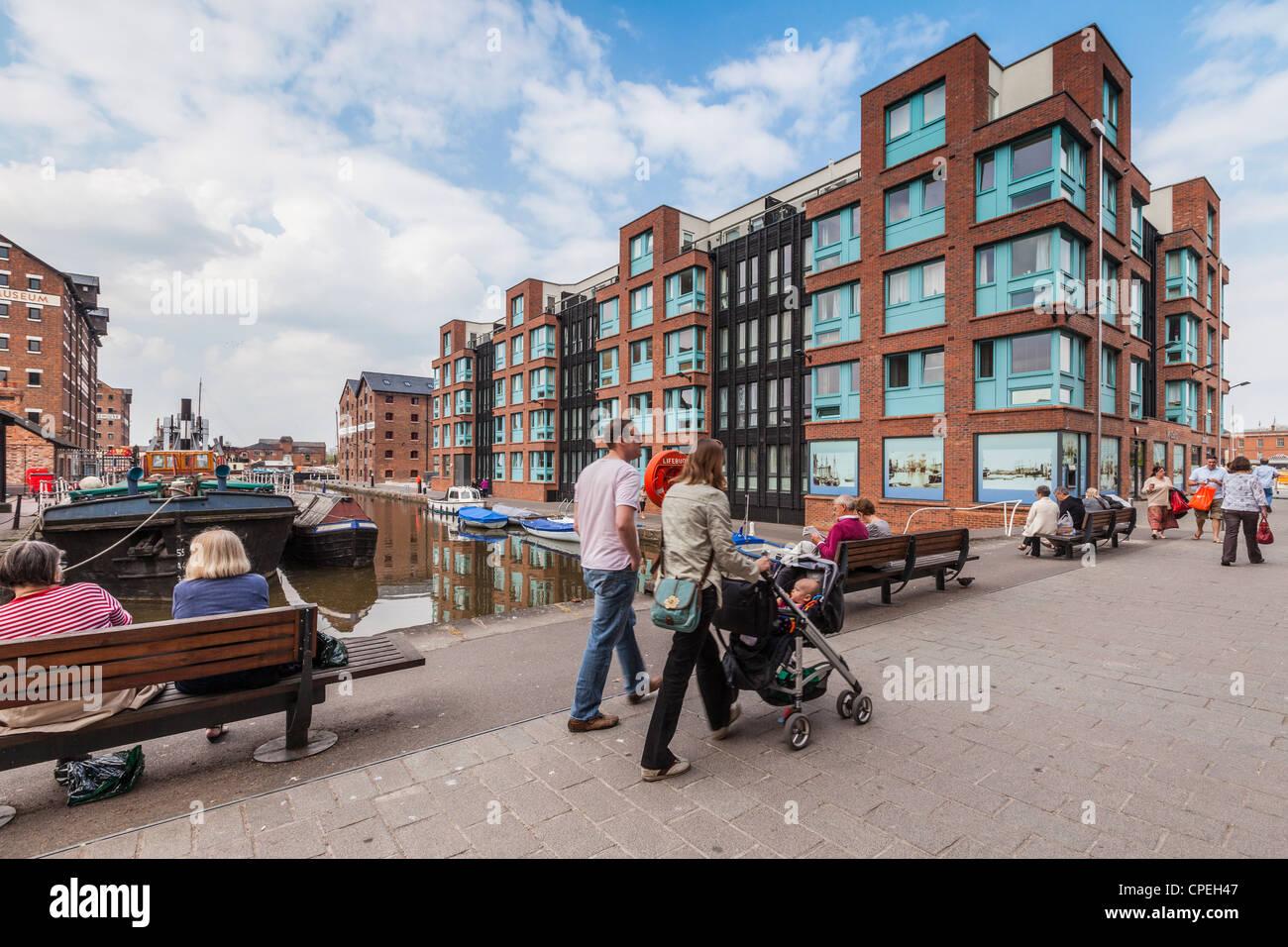 People at Gloucester Docks Gloucestershire England - Stock Image