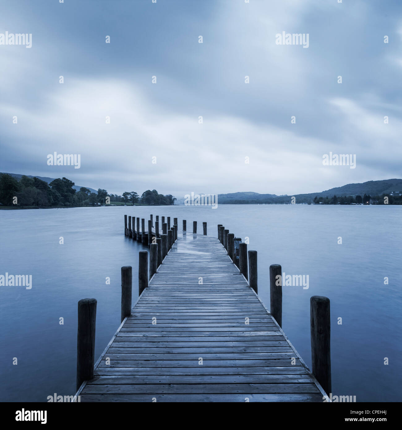 A stormy start to the day at Coniston Water in the English Lake District. Square format. - Stock Image