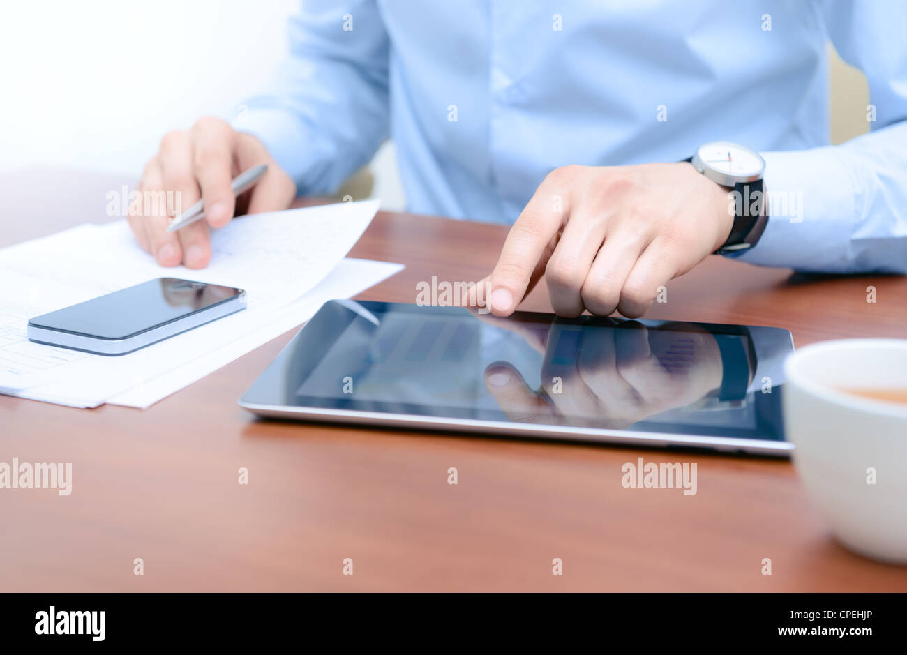 Businessman using new technologies for success workflow. - Stock Image