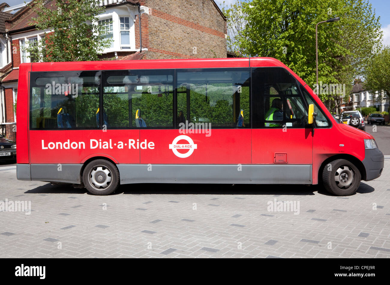 London Dial-a-Ride bus service in North London street - Stock Image