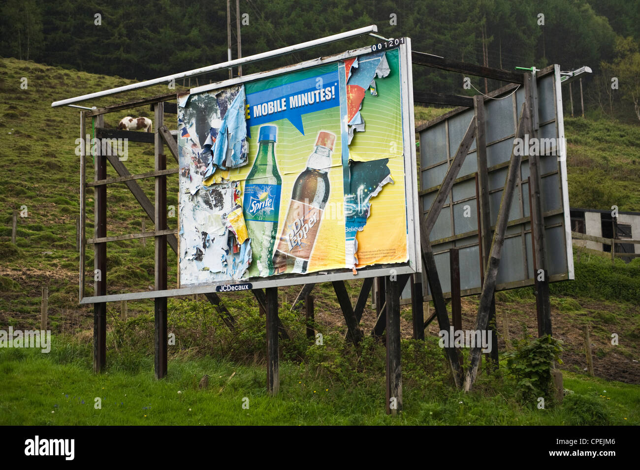 Derelict JCDecaux billboard advertising site on roadside near Merthyr Tydfil South Wales UK - Stock Image