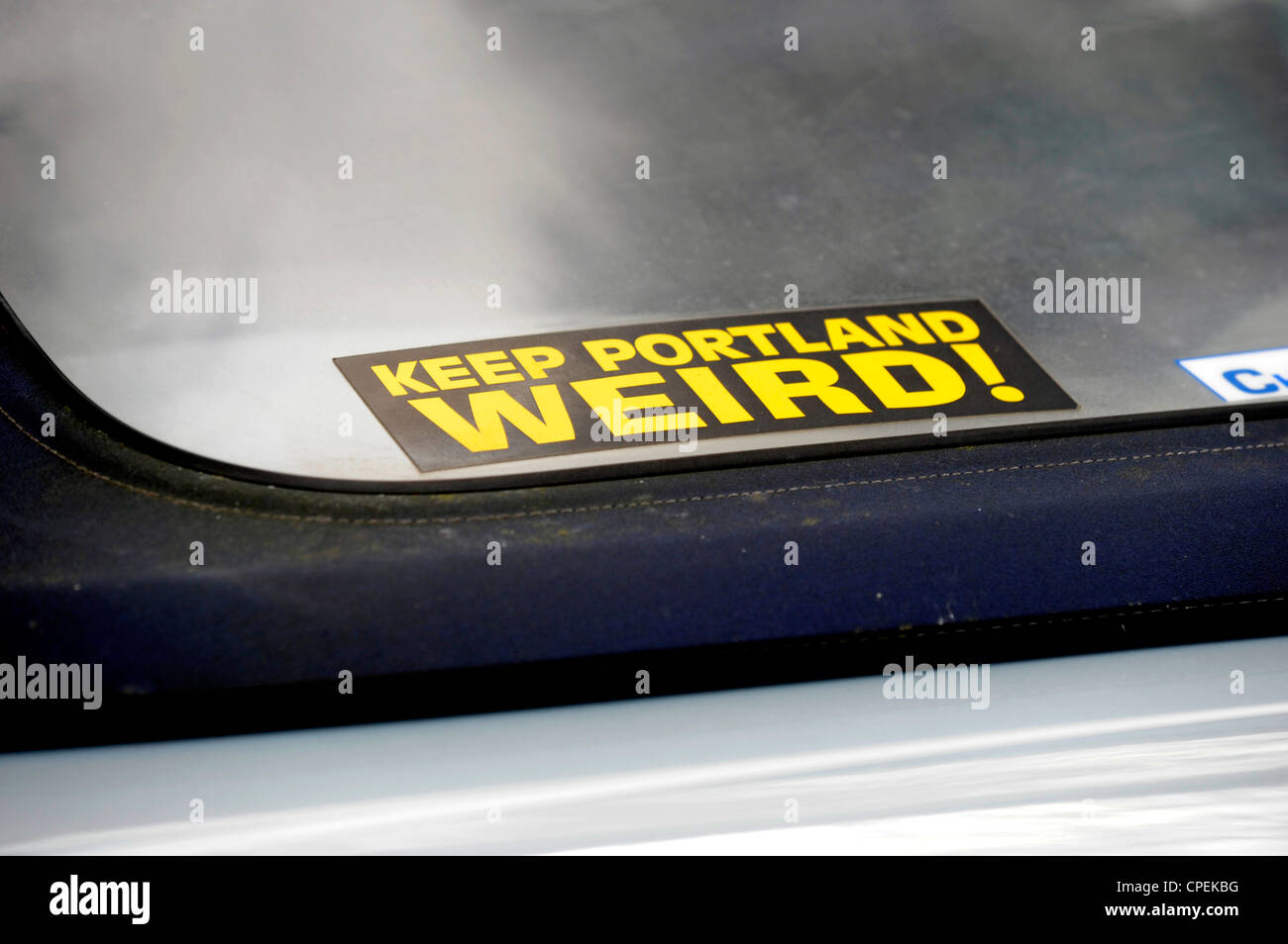 Keep Portland Weird sticker seen on car rear windscreen - Stock Image