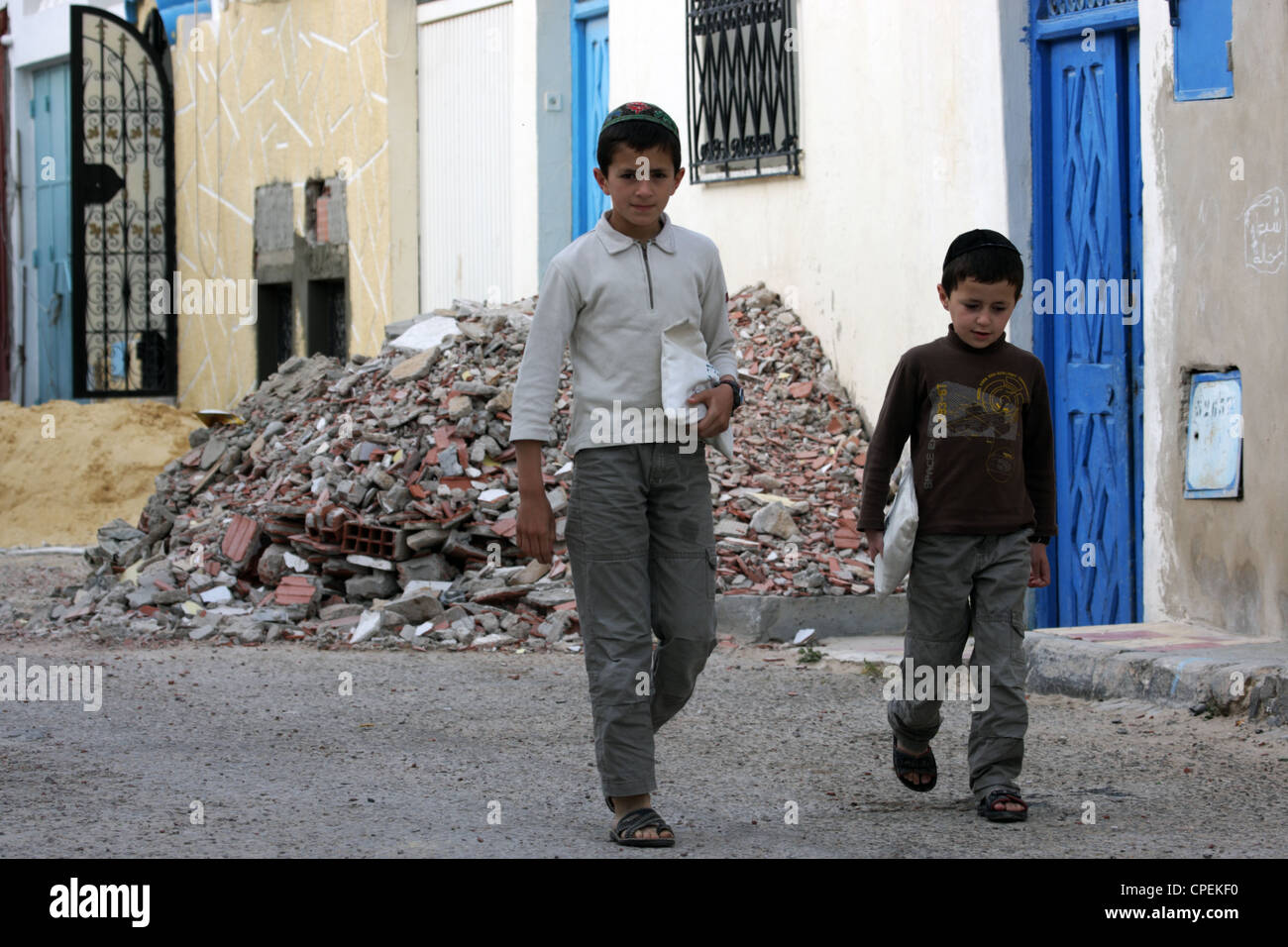 Two young Jewish schoolboys on their way to school on the Tunisian island of Djerba - Stock Image