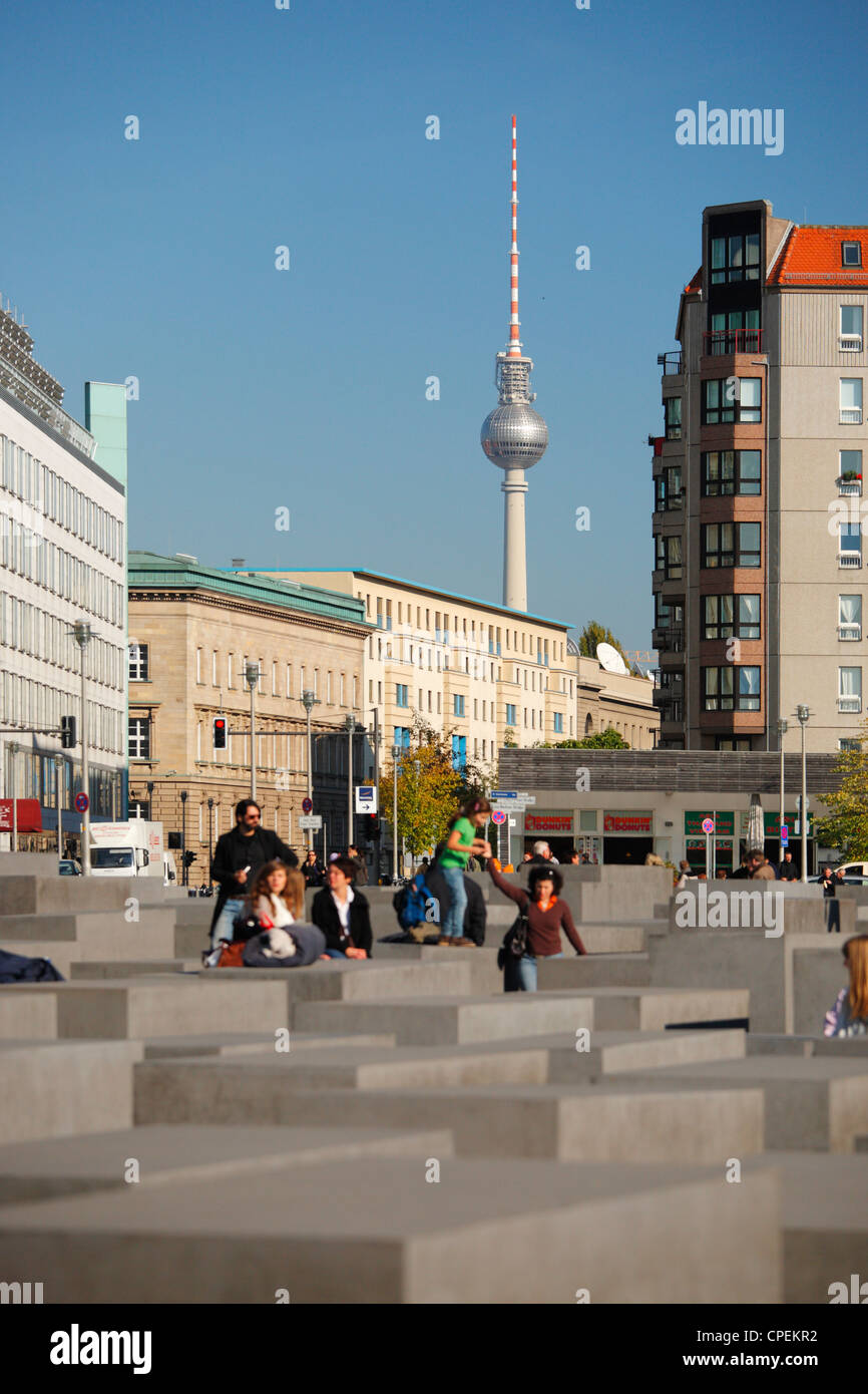 The Memorial to the Murdered Jews of Europe in Berlin, Germany; TV tower in the background - Stock Image
