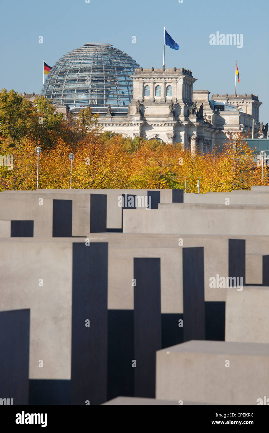 The Memorial to the Murdered Jews of Europe in Berlin, Germany; Reichstag in the background - Stock Image