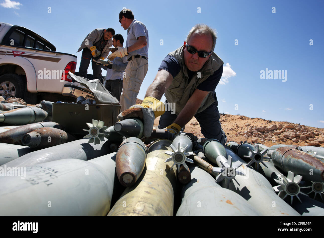 International bomb disposal members prepare demolition of unexploded ordnance near Sirte, Libya - Stock Image