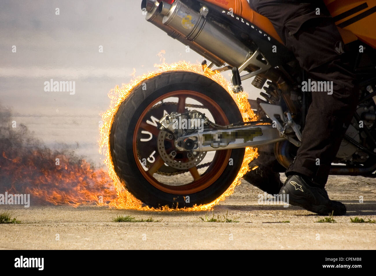 Unusual burnout by a modern and powerful motorcycle. - Stock Image