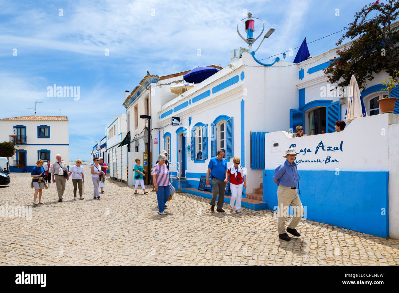 Tourists in the village of Cacela Velha near Tavira, Eastern Algarve, Portugal - Stock Image