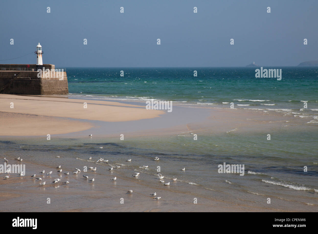 View out to sea from the harbour, St Ives, Cornwall, England, UK. Seagulls on the beach. Stock Photo