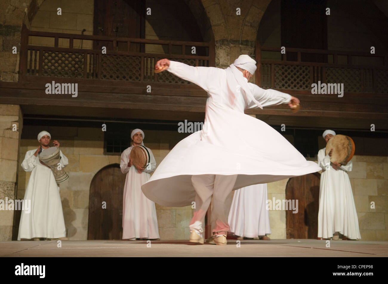 whirling dervish Sufi dancer in motion at performace in Cairo Egypt - Stock Image