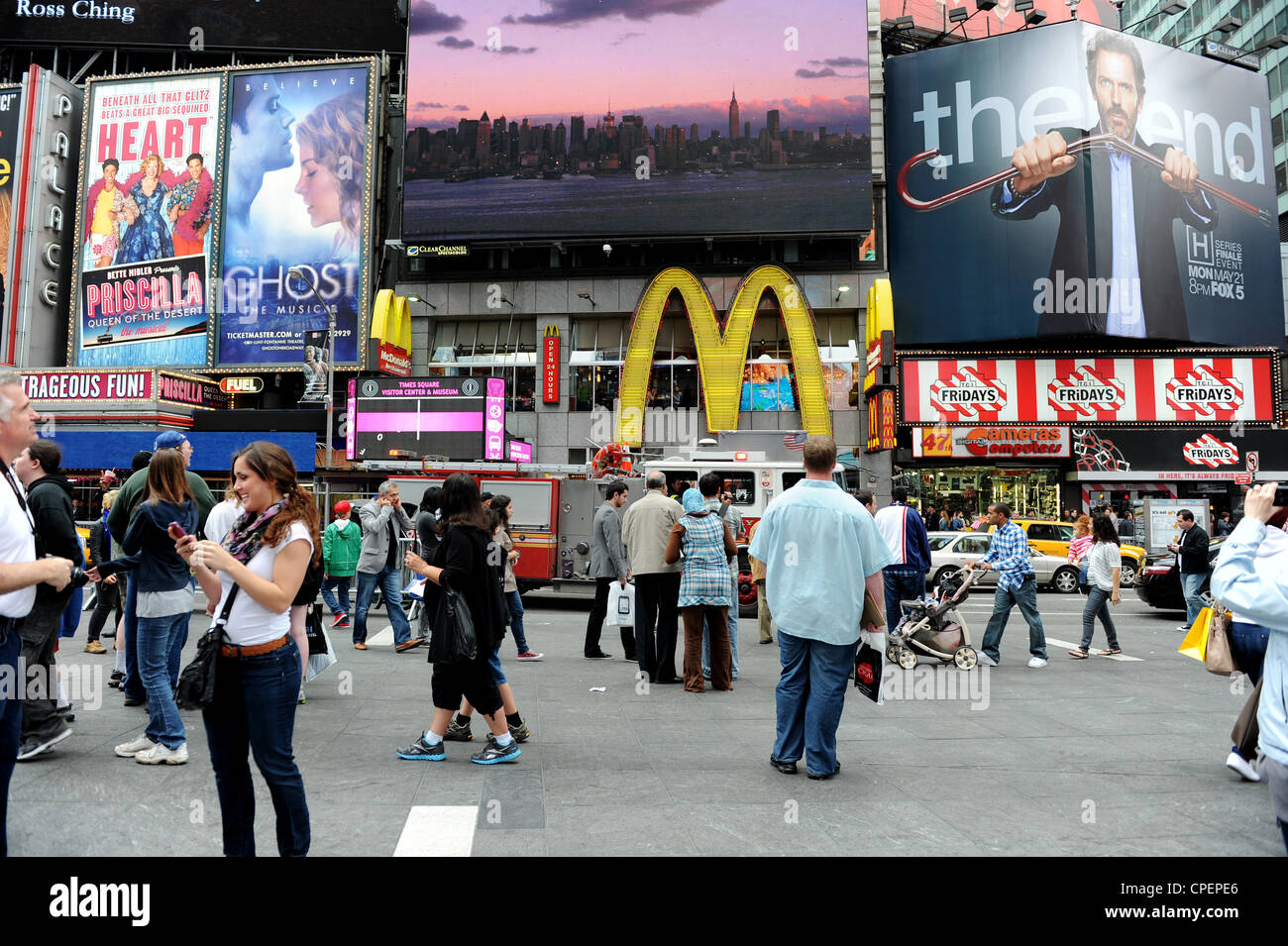 Tourists in Times Square, New York - Stock Image