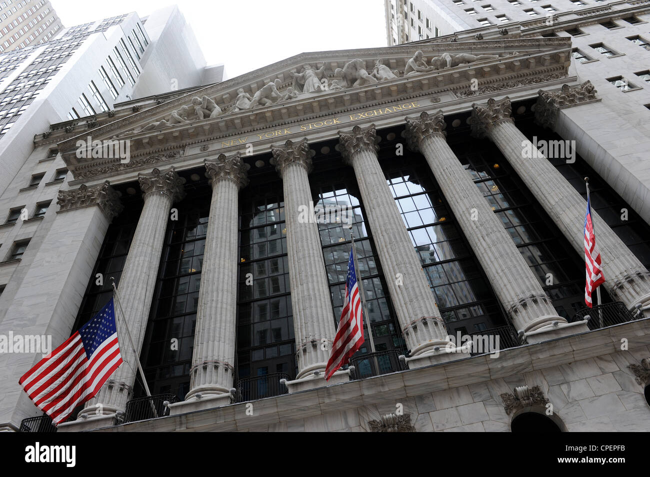 Flags outside The New York Stock Exchange, New York - Stock Image