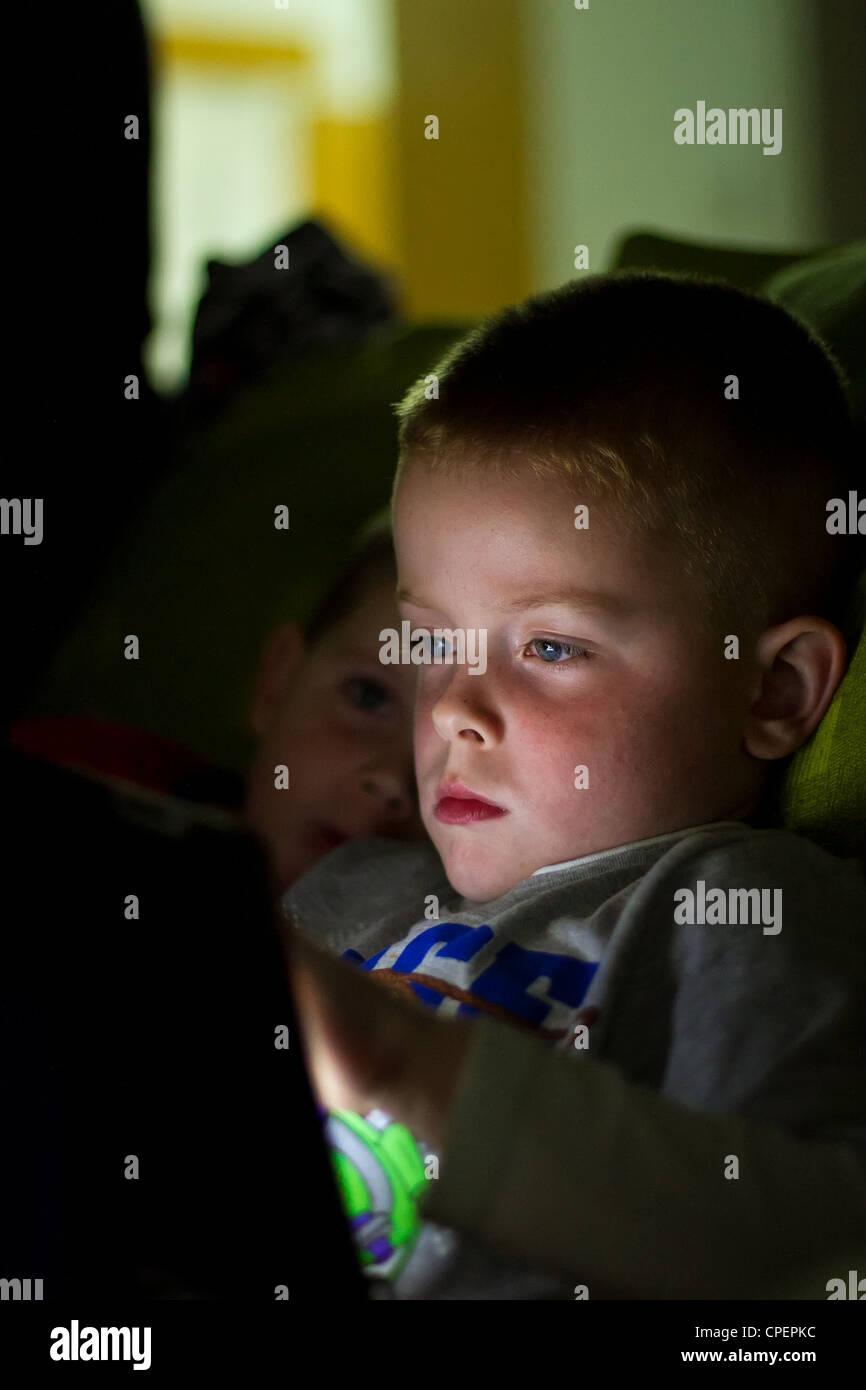 tablet boy - Stock Image