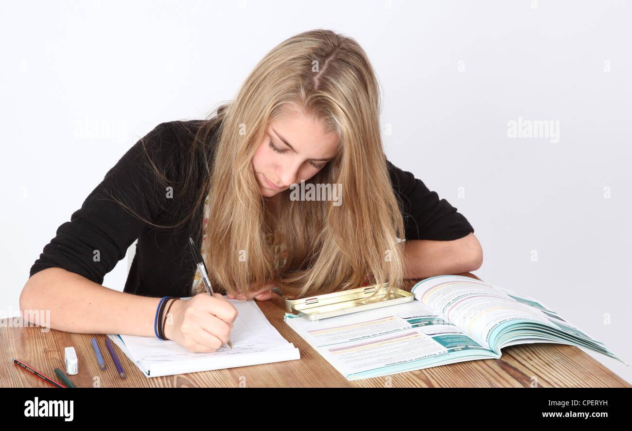 Teenage girl studying. - Stock Image
