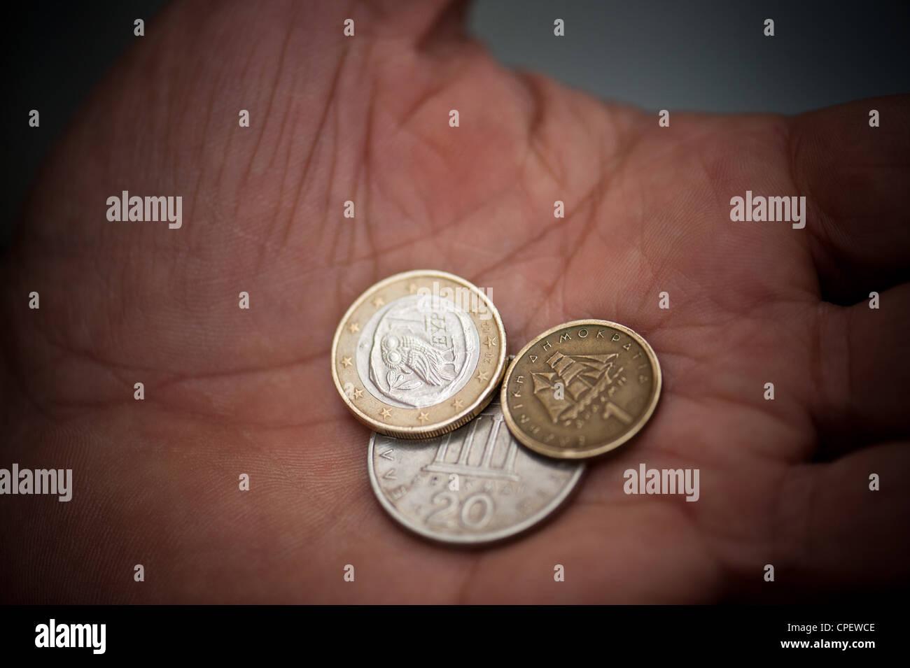 One euro coin together with 20 drachma coin and a one drachma coin - Stock Image