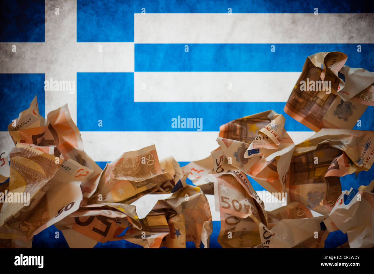 Wrinkled 50 euro notes in front of the Greek flag - Stock Image