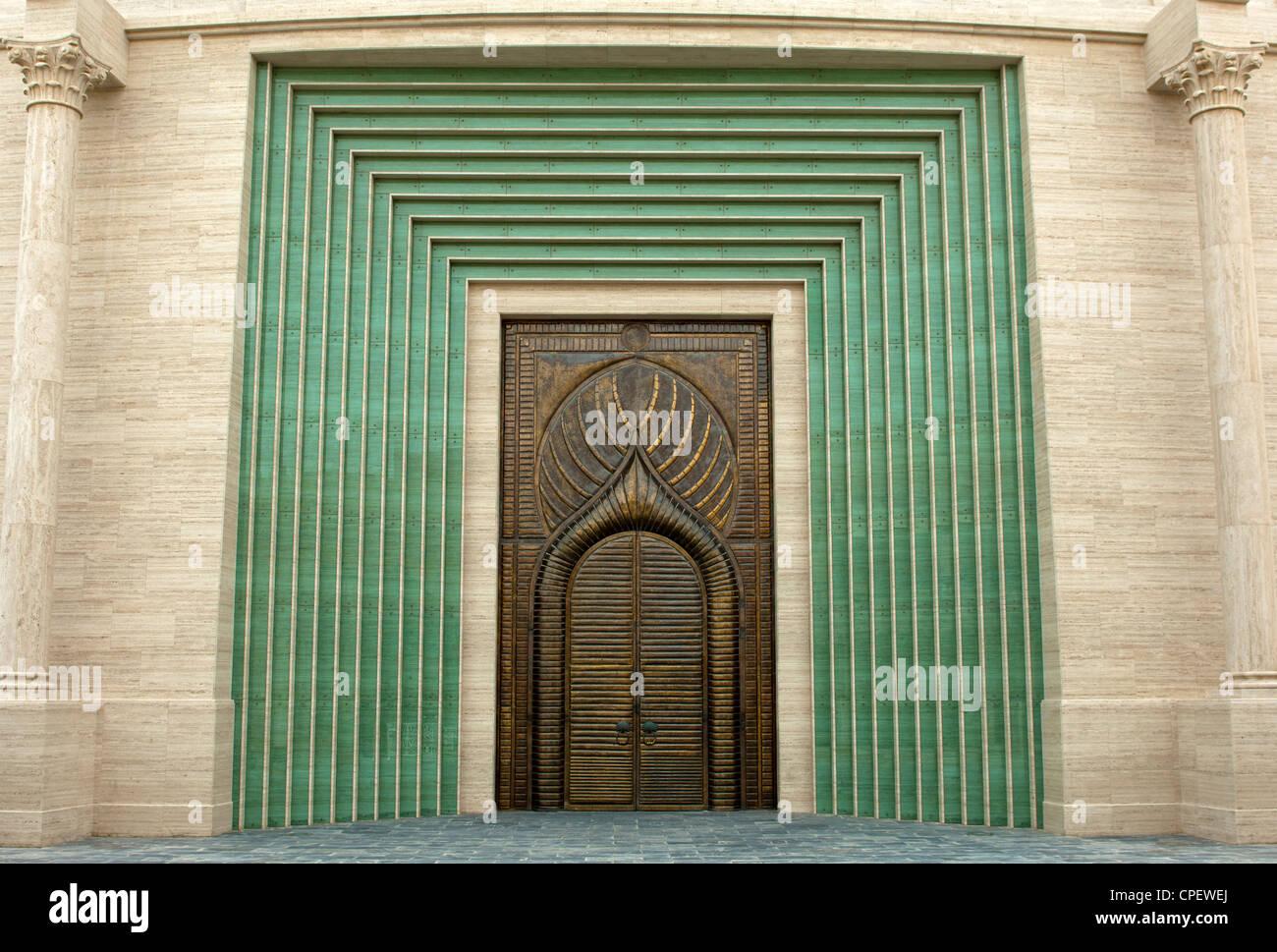 Ornate copper door of the portal of the amphitheatre at the Katara Cultural Village, Doha, Qatar - Stock Image