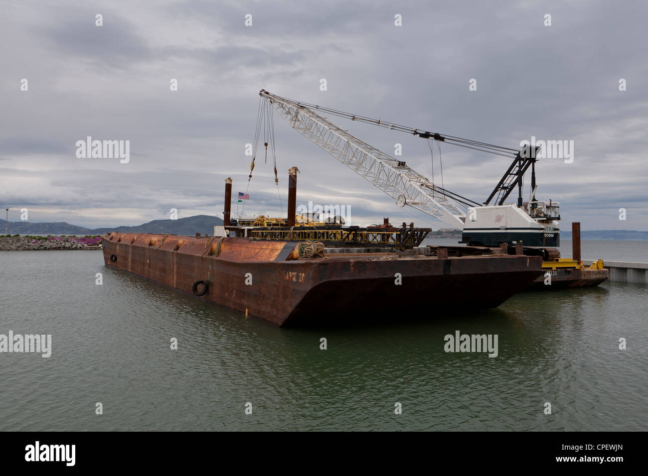 An old rusty barge on water - Stock Image