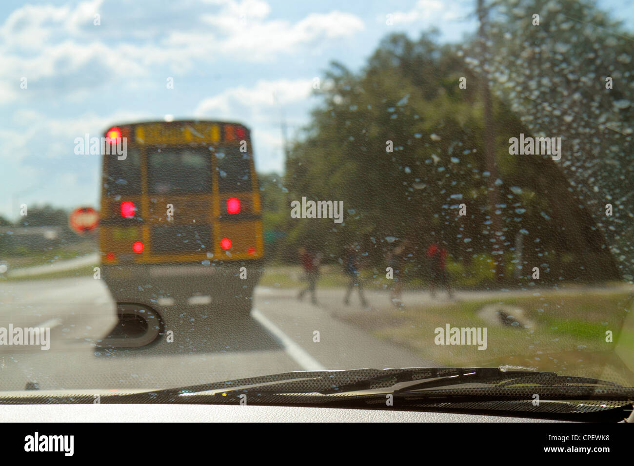 Florida Bartow State Road 60 highway public school bus yellow stopped dropping off student after school automobile - Stock Image