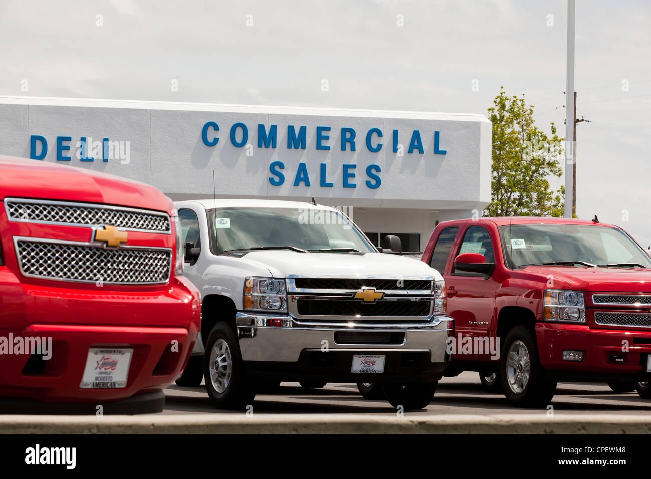 New Chevrolet trucks on sale at dealership sales lot - California USA - Stock Image