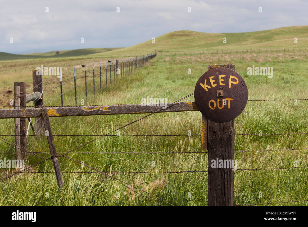 Old Keep Out sign in rural America - Stock Image