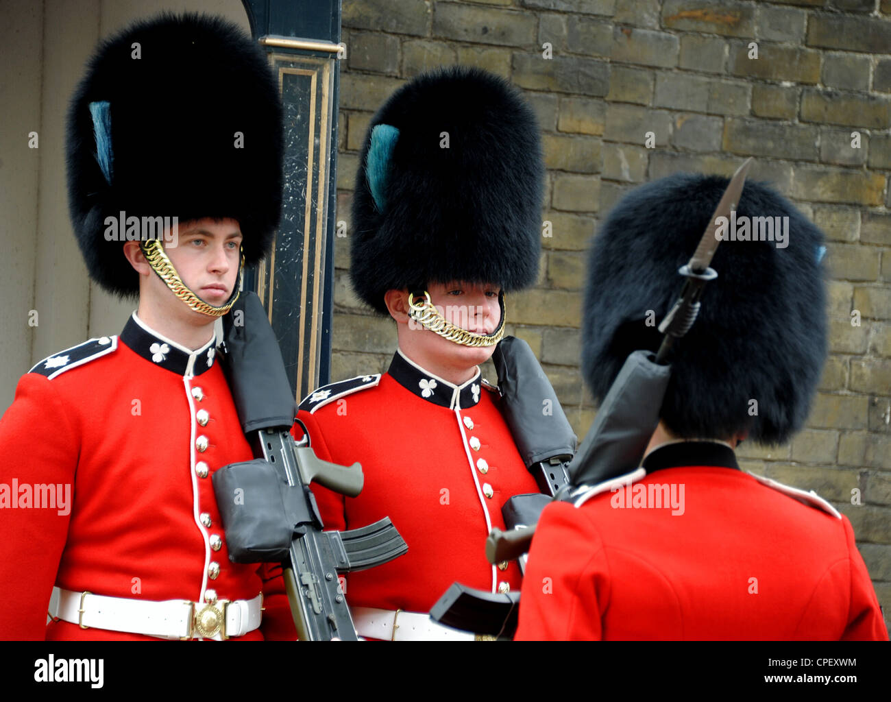 Queen's household guardsmen on guard near The Mall. - Stock Image