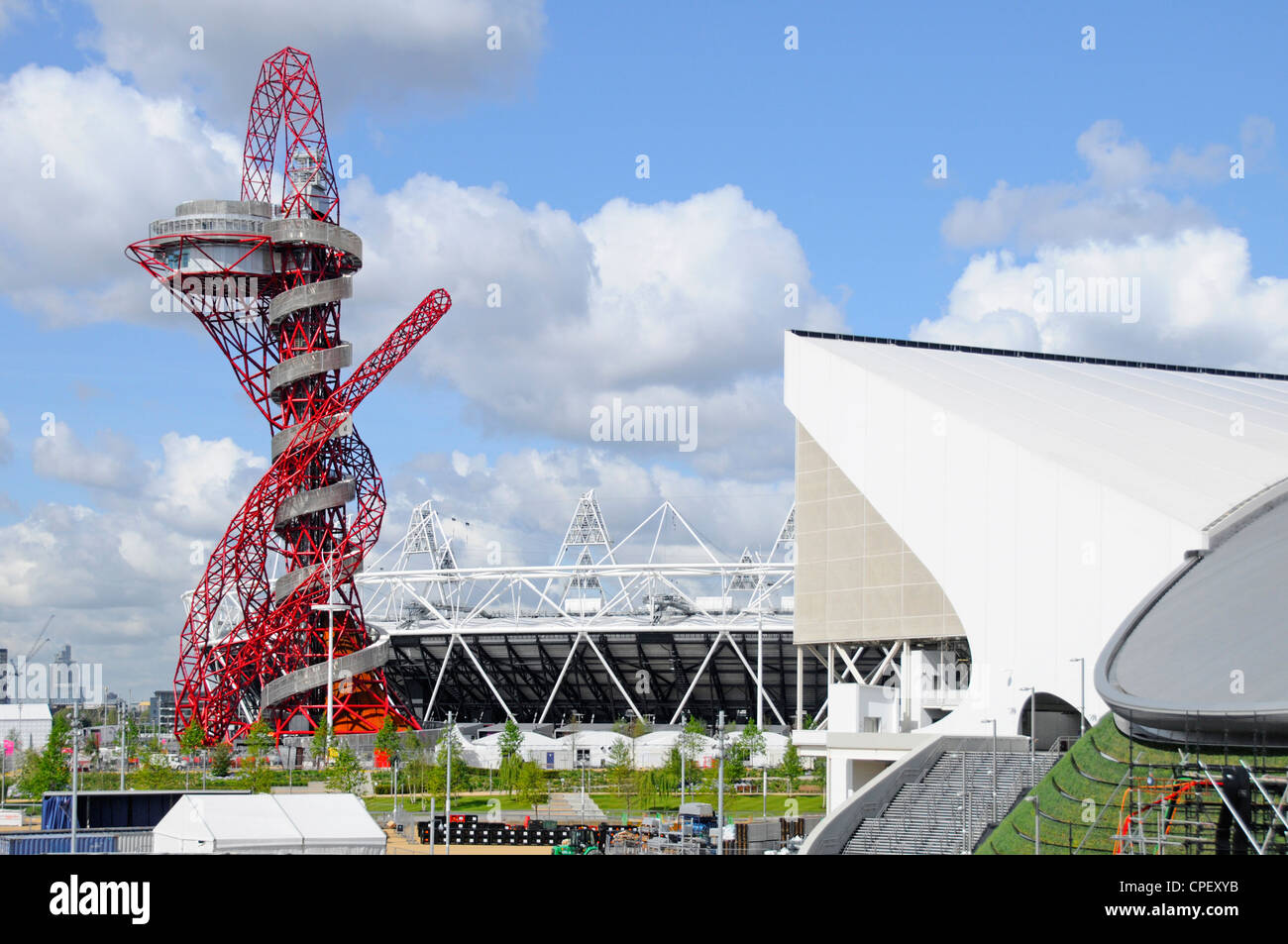 ArcelorMittal Orbit tower with part of main stadium & Aquatic Centre in The 2012 London Olympic park - Stock Image