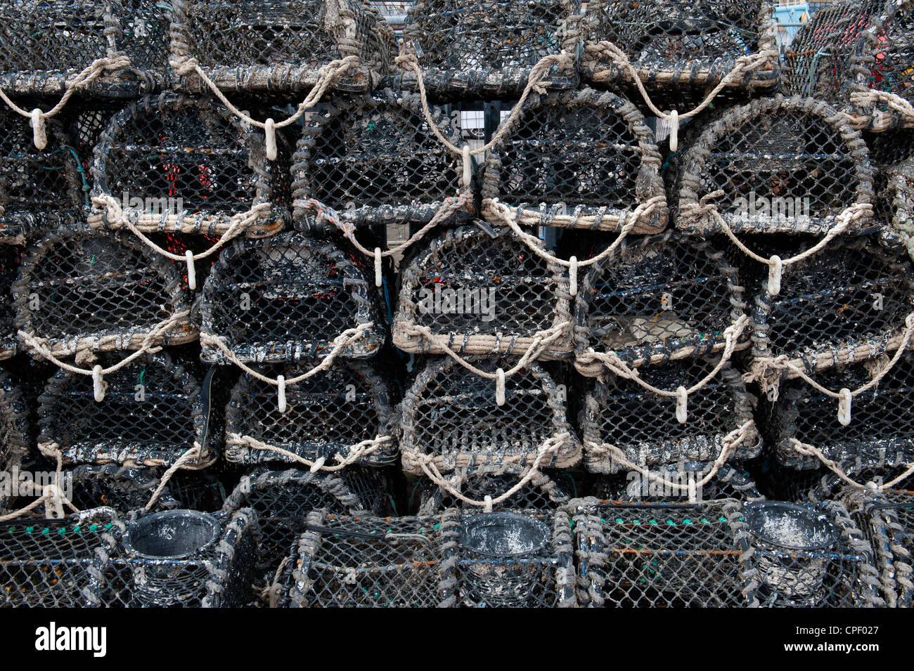 Stacked lobster fishing pots. Devon, England - Stock Image