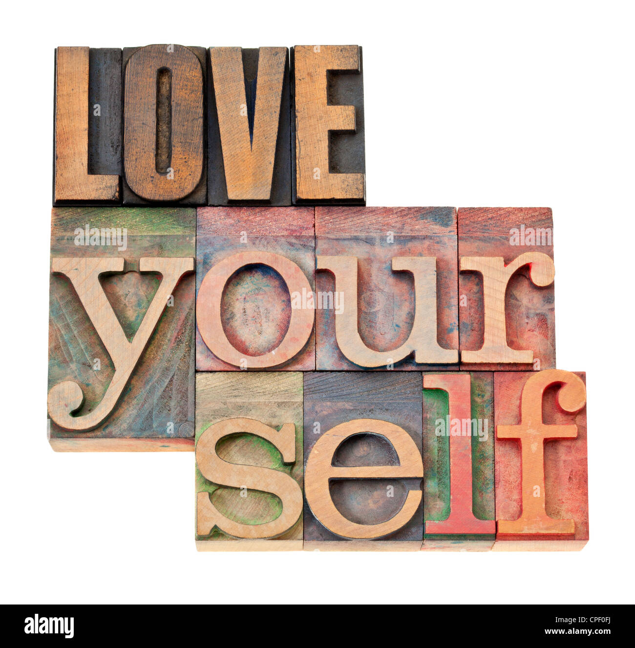 love yourself - self esteem concept - isolated text in vintage letterpress wood type - Stock Image