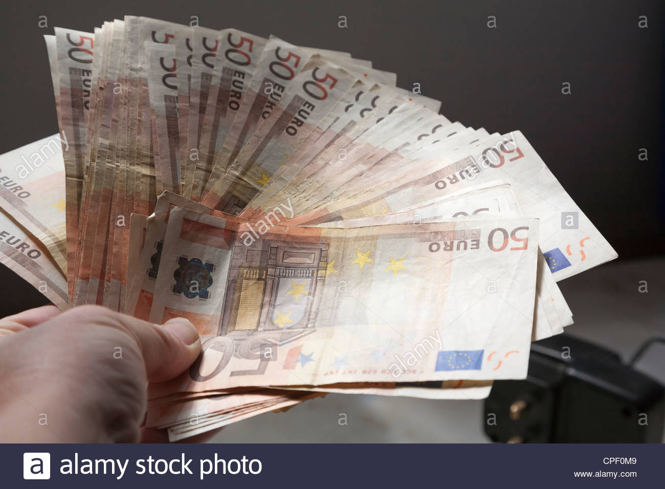 euro notes being handed over - Stock Image