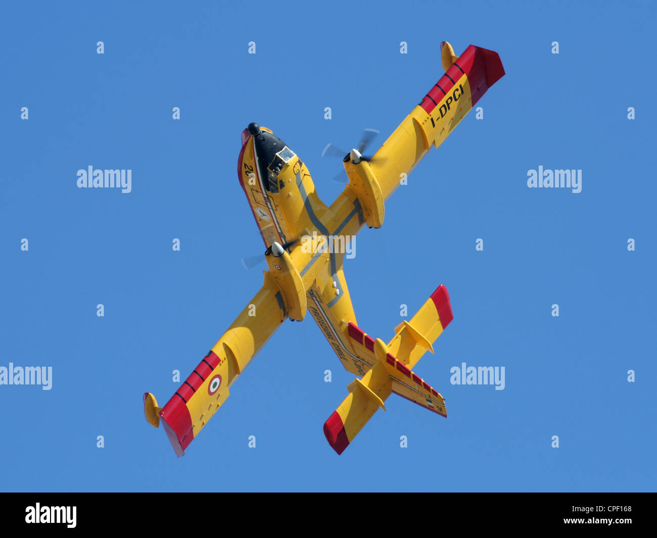 Italian Bombardier 415 (Canadair CL-415) twin engine turboprop waterbomber plane displaying its agility - Stock Image