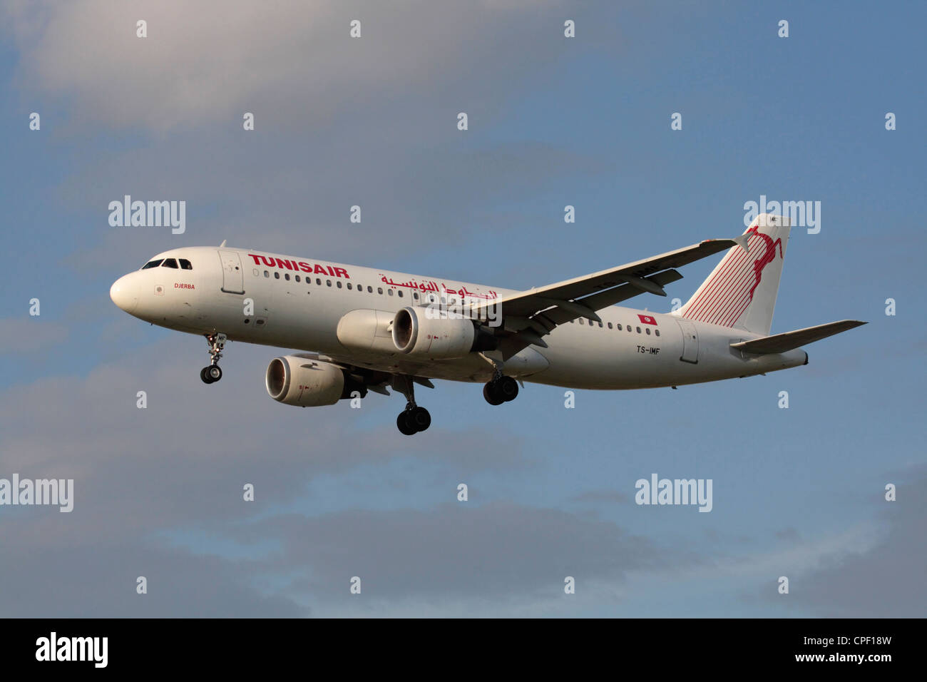 Tunisair Airbus A320 commercial airliner flying on approach - Stock Image