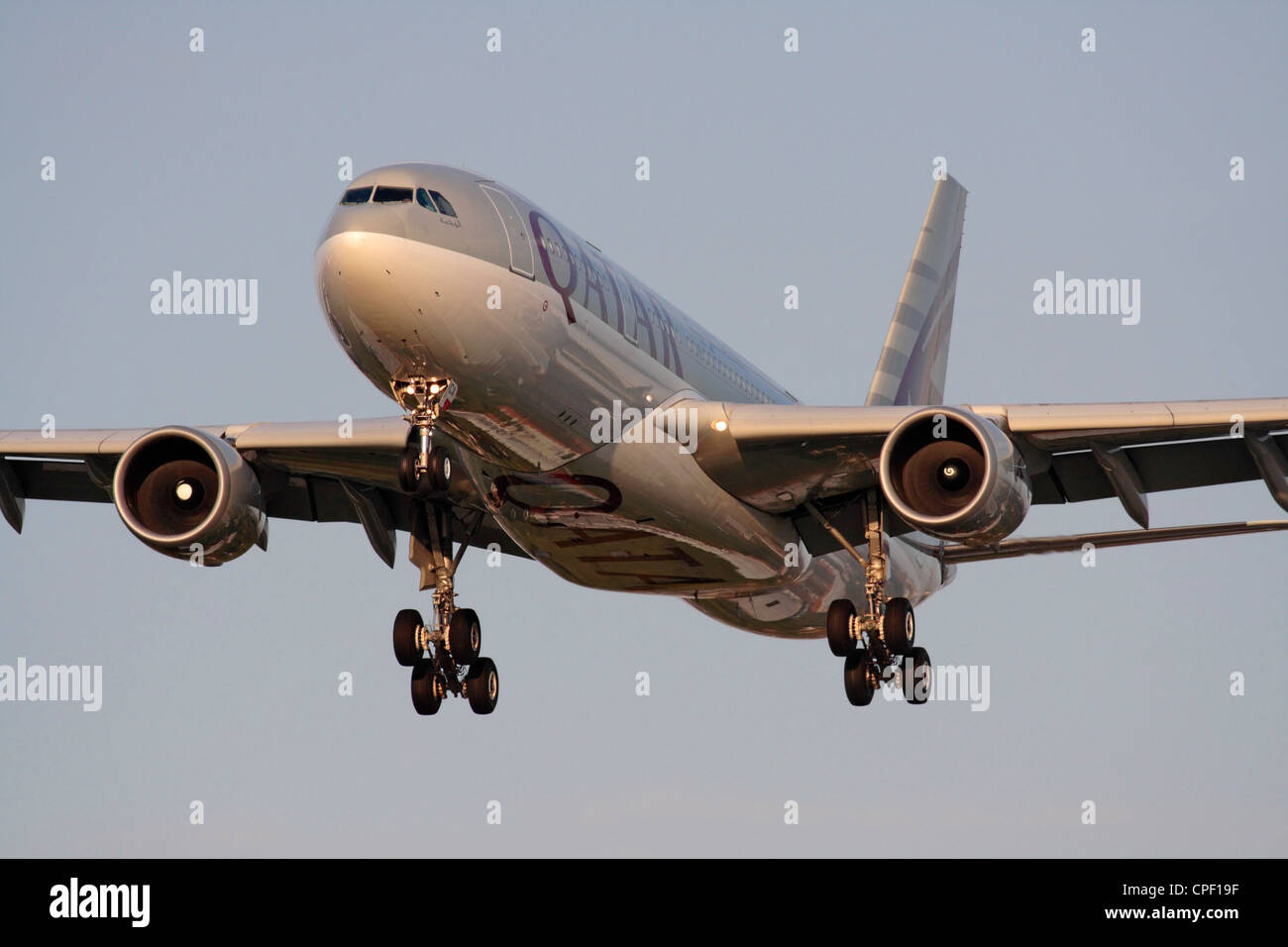 Qatar Airways Airbus A330-200 on arrival at sunset - Stock Image
