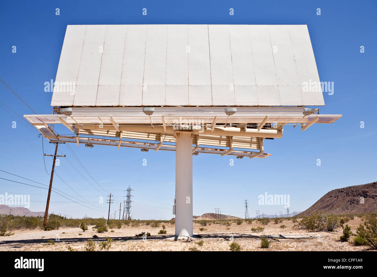 Old blank billboard in the middle of California's Mojave desert. - Stock Image