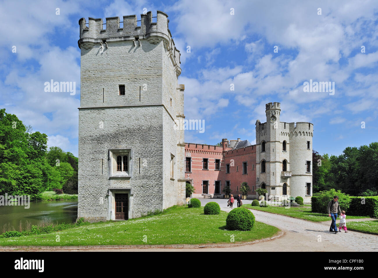 Tourists at the Bouchout Castle in Neo-Gothic style surrounded by moat in the National Botanic Garden of Belgium Stock Photo