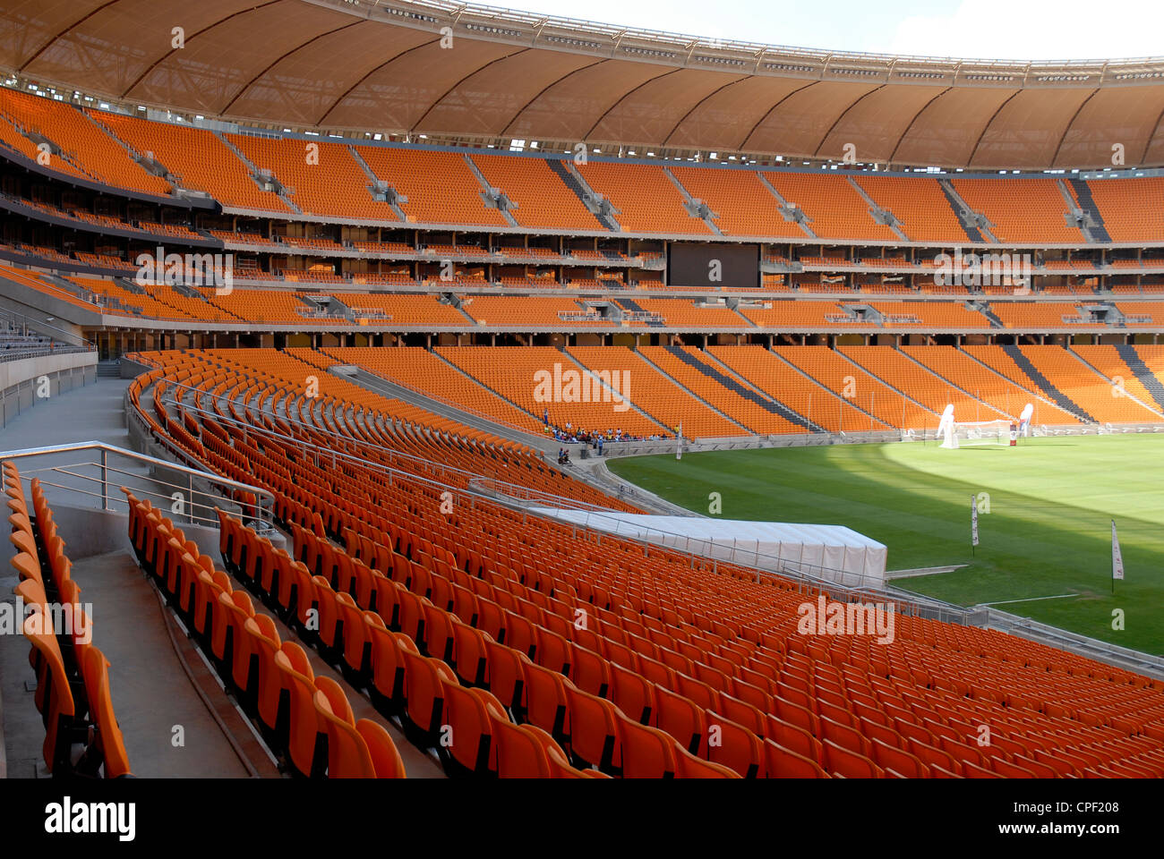 The interior and exterior of Soccer City stadium