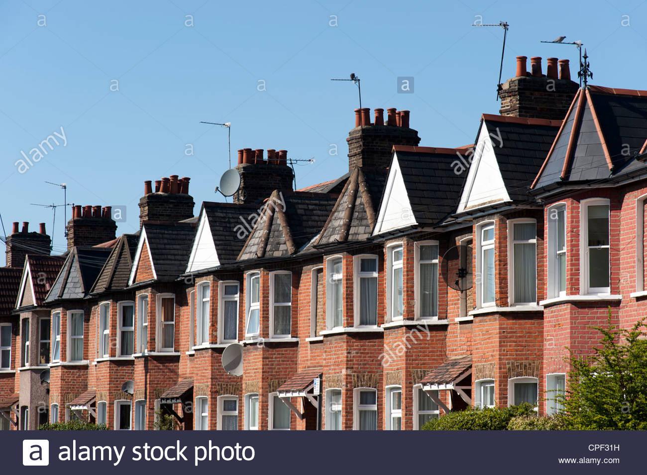 Row of terraced houses, Haringey, London, England, UK - Stock Image
