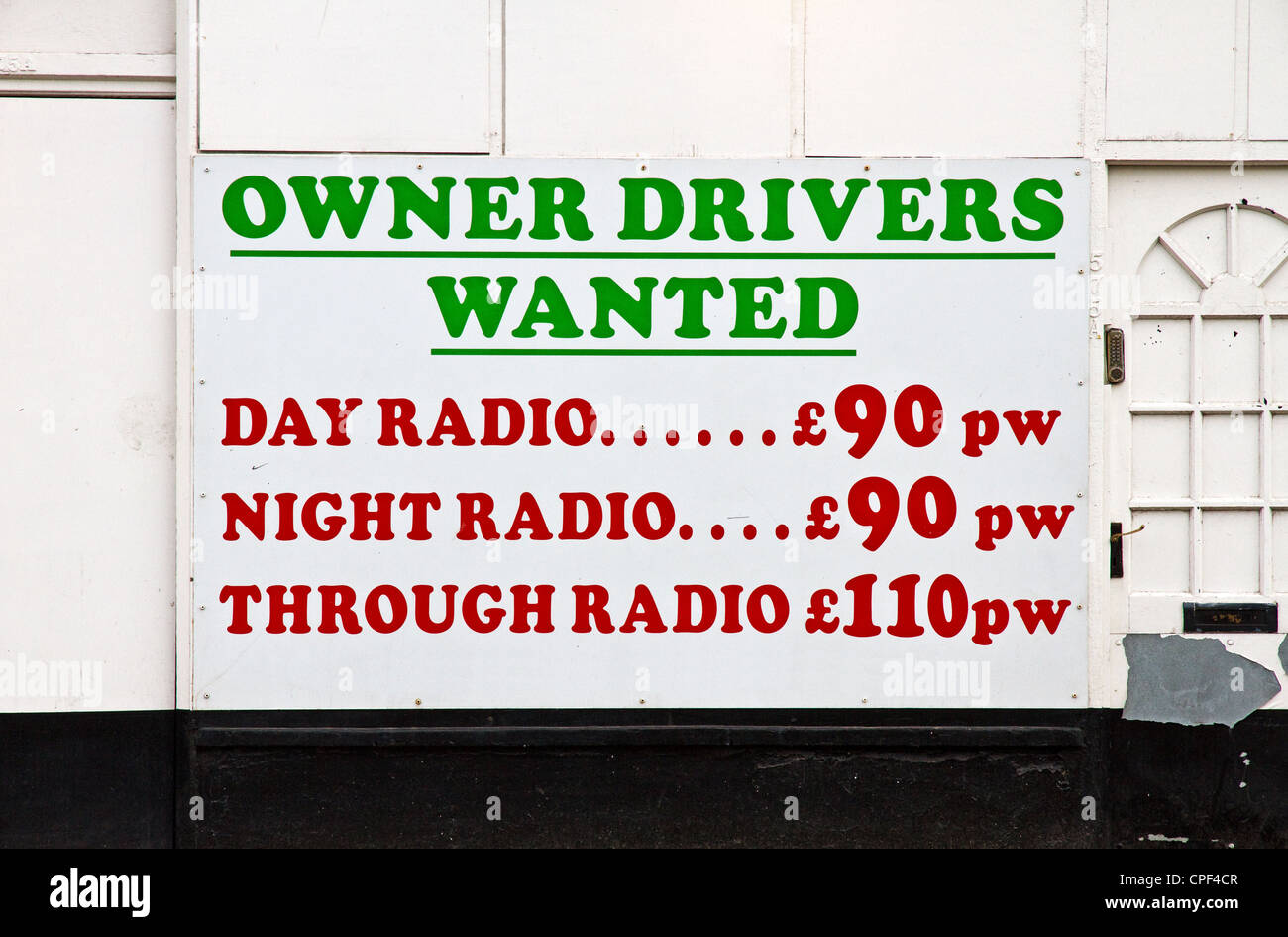 Private hire taxi owner drivers wanted sign, Irlam, Greater Manchester, England, UK - Stock Image