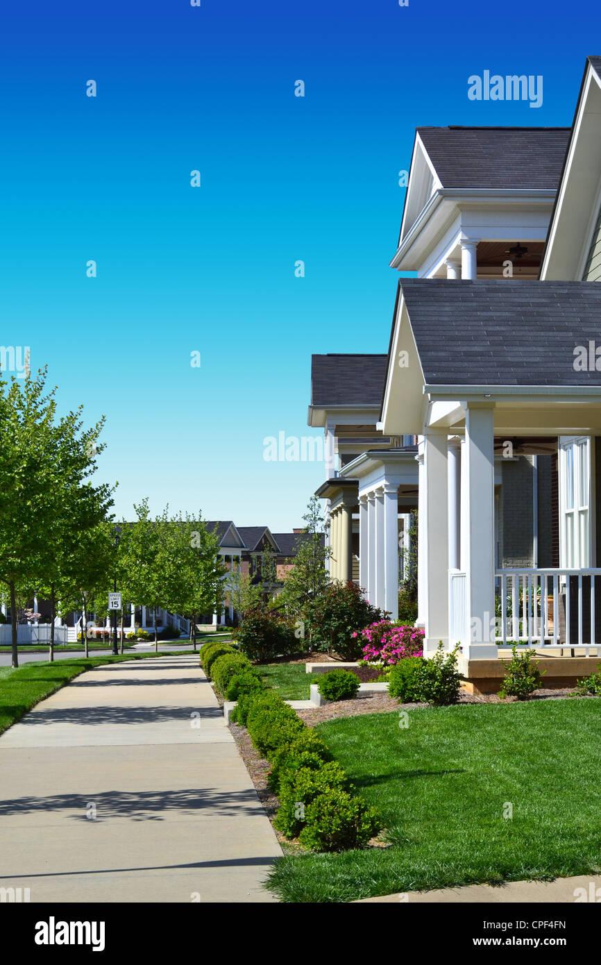 Neighborhood with sidewalks - Stock Image