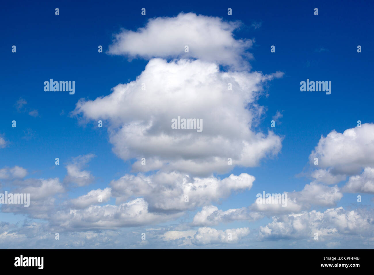 Fluffy Clouds and Blue Sky Stock Photo