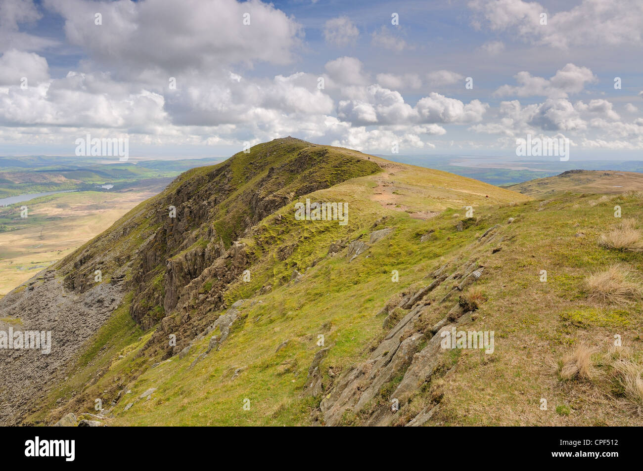 Fluffy clouds over Brown Pike in the English Lake District - Stock Image