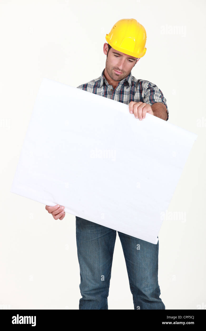 Workers examining white plate - Stock Image