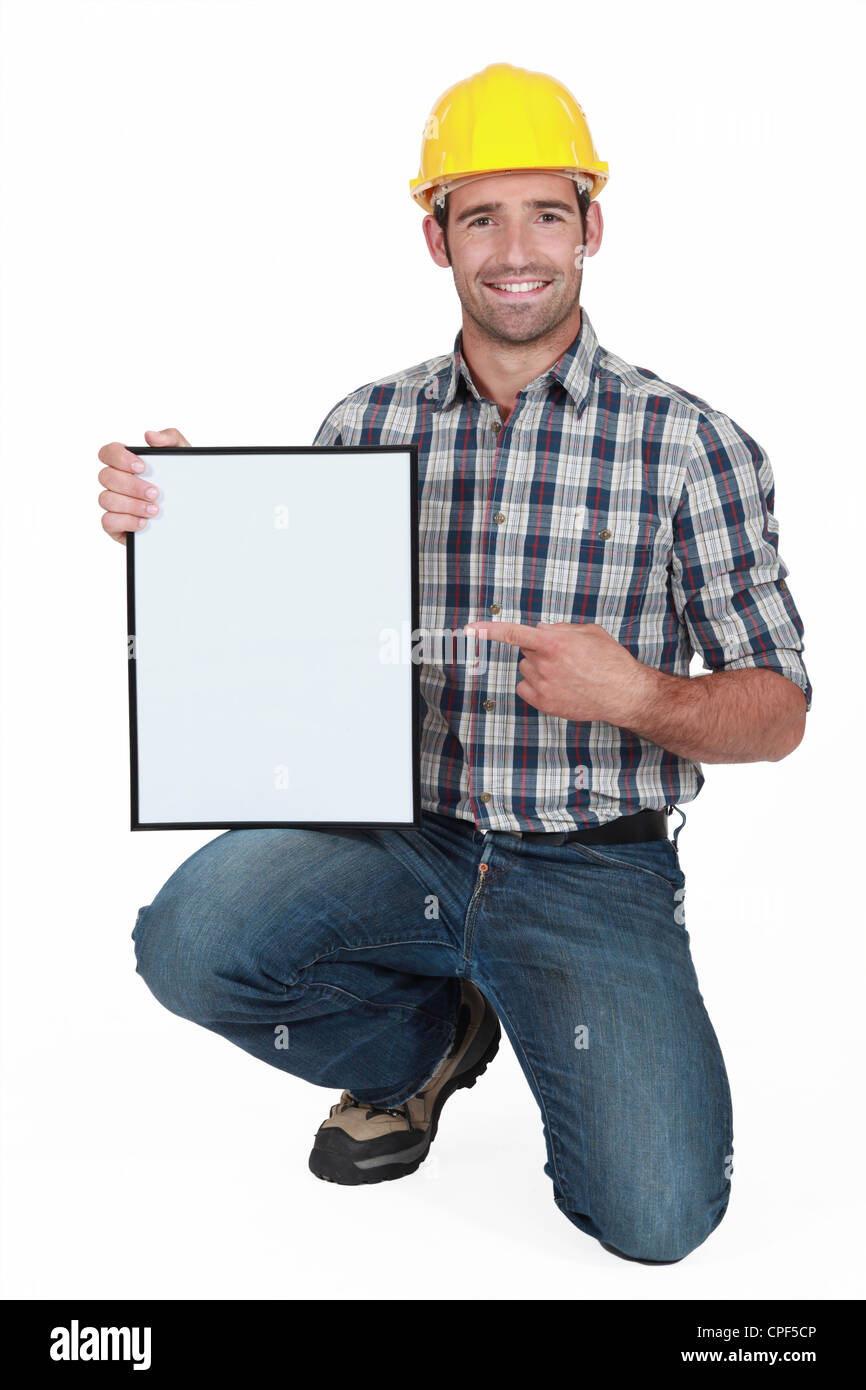 craftsman pointing at a blank board - Stock Image