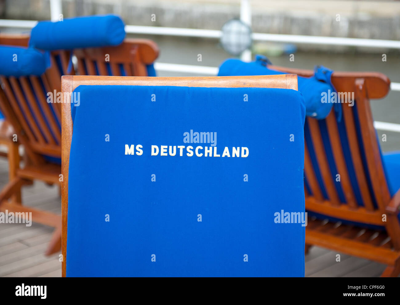 Deckchairs with branded cushion aboard the super deluxe cruise liner MS Deutschland, operated by Reederei Peter - Stock Image
